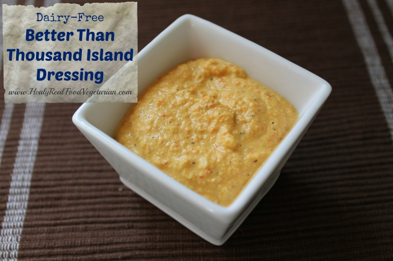A side shot of dairy free thousand island dressing in a square white ramekin