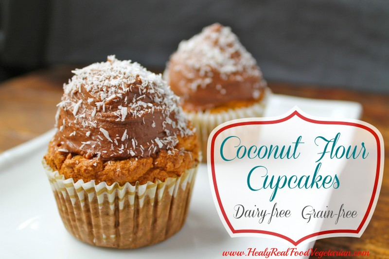 Two coconut flour cupcakes topped with chocolate frosting and shredded coconut