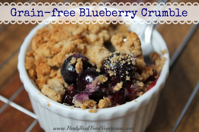 A close up of grain-free blueberry crumble in a white ramekin