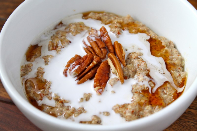 A photo of a bowl of porridge topped with nuts