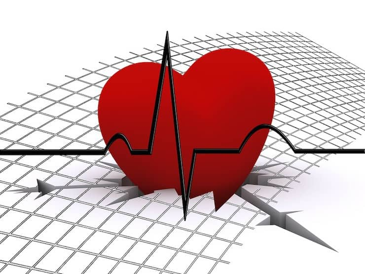 Illustration of a red heart cracking the white surface with a heart monitor line through it