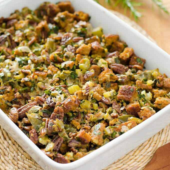 A close up a paleo cornbread stuffing in a white casserole dish