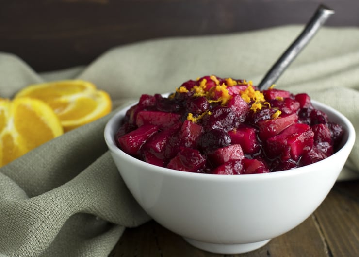 Cranberry sauce in a bowl topped with orange
