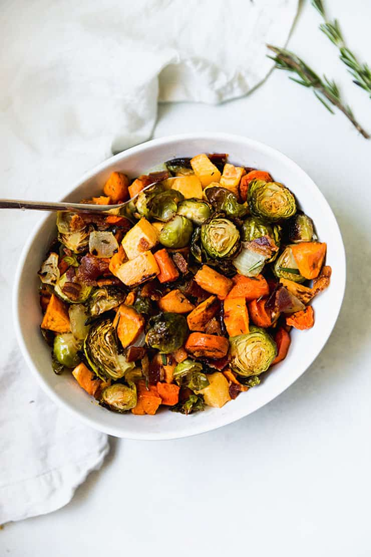 An overhead shot of roasted sprouts and vegetables in a bowl