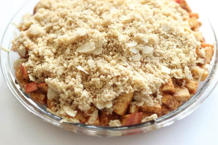 A close up of a Paleo Apple Crisp in a glass dish
