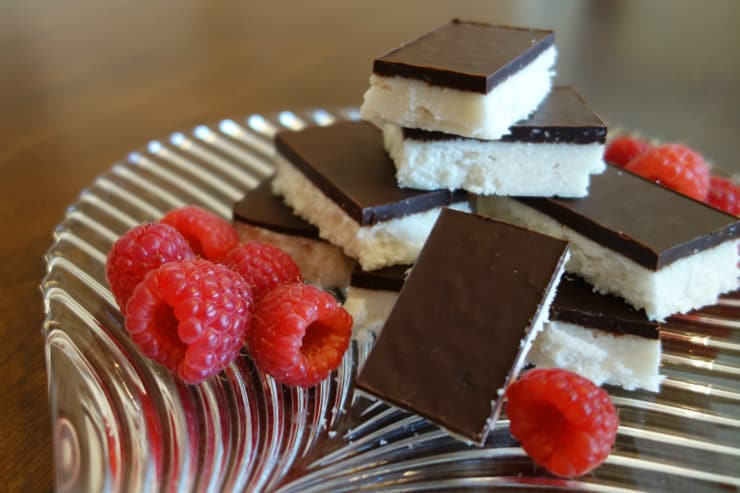 Chocolate coconut bars on a glass plate