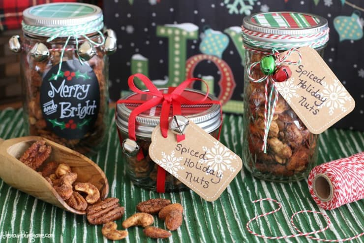 SPiced nuts in jars wrapped with ribbons