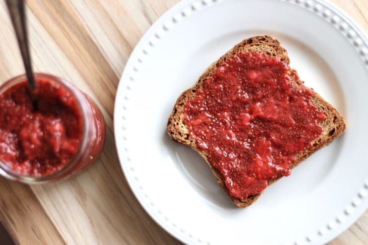 A slice of toast with chia strawberry jam spread on top