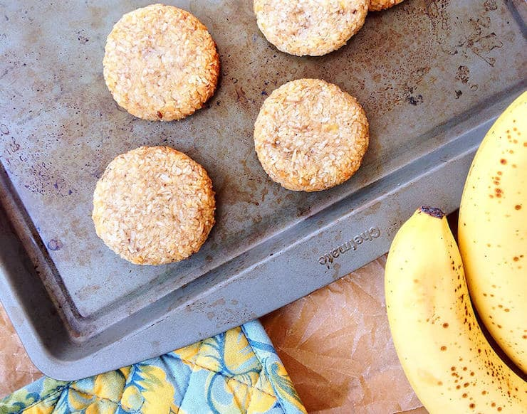 cookies on a baking sheet with bananas next to it