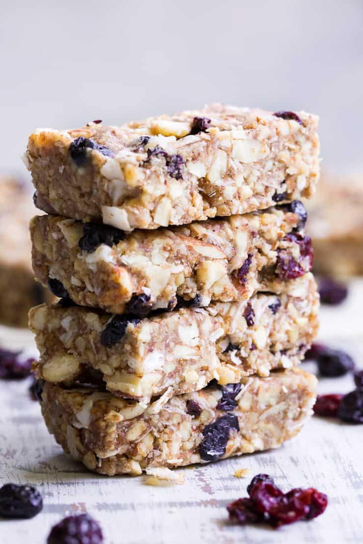 four stacked granola bars on white surface
