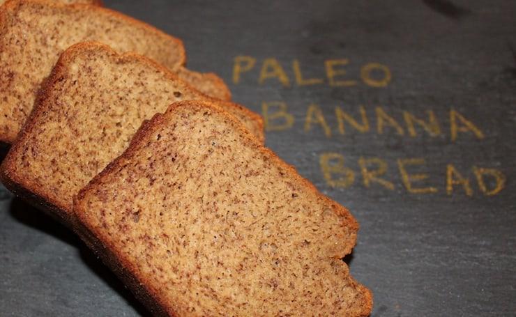 three slices of banana bread on black granite