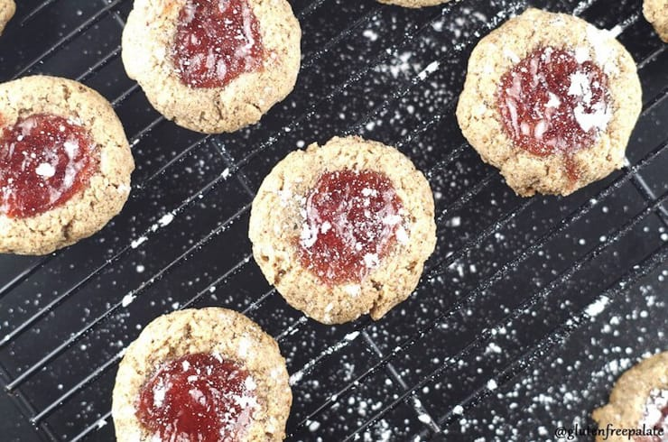 Grain free thumbprint cookies sitting on a cooling rack