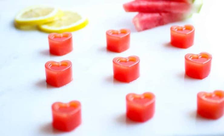 Heart shape gummies on a white surface