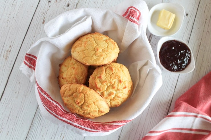 Dish towel lined bowl filled with yellow paleo biscuits