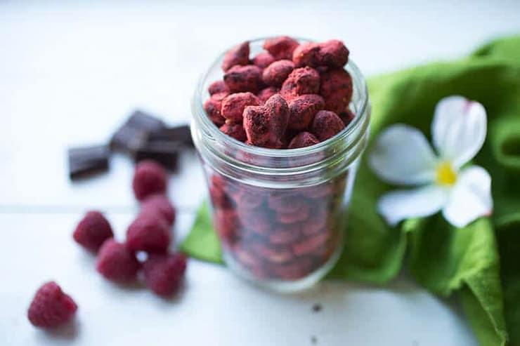 heart shaped pink chocolates in a mason jar