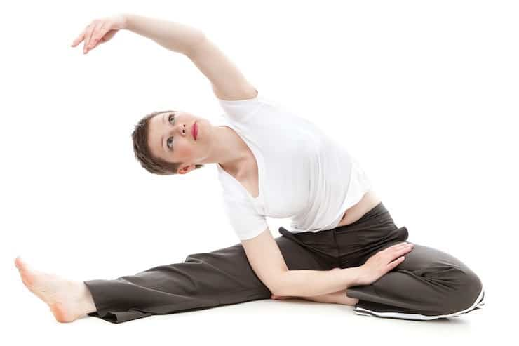 Woman in exercise clothing stretching