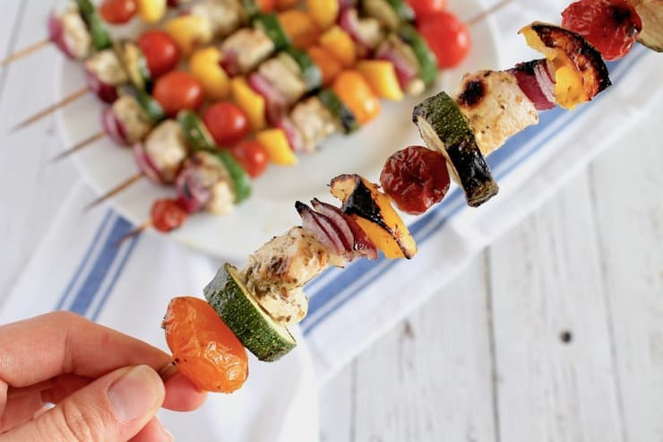 Close up of chicken kabob with veggies and chicken on wooden skewer