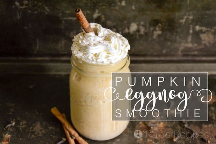 Clear jar filled with pumpkin eggnog smoothie topped with whipped cream and a cinnamon stick
