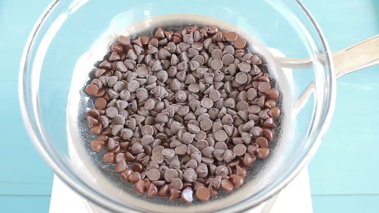 Clear bowl filled with partially melted chocolate chips