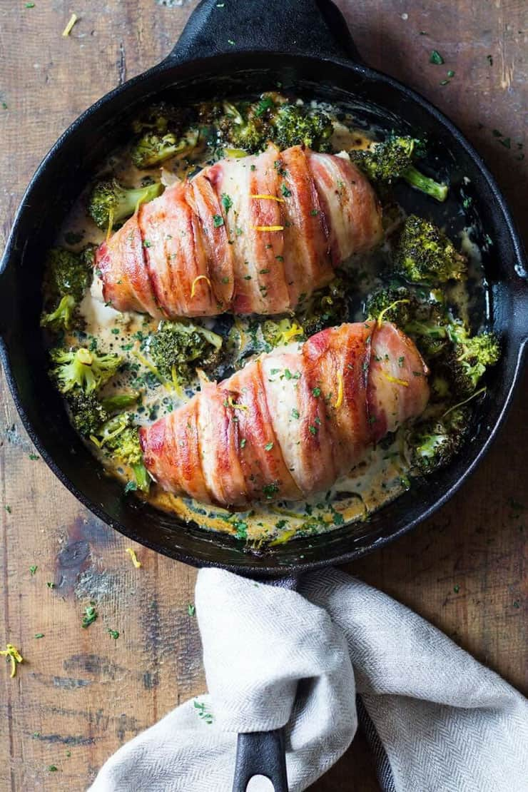 A keto recipe for chicken wrapped in bacon and served with broccoli