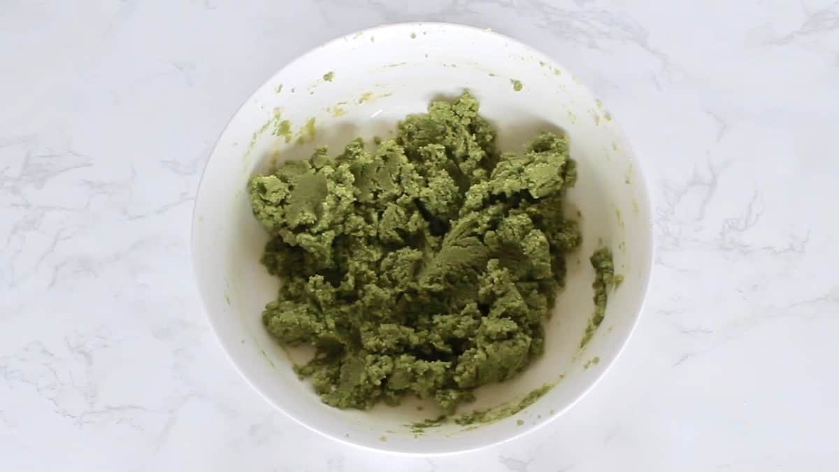 Green matcha cookie dough in a white bowl