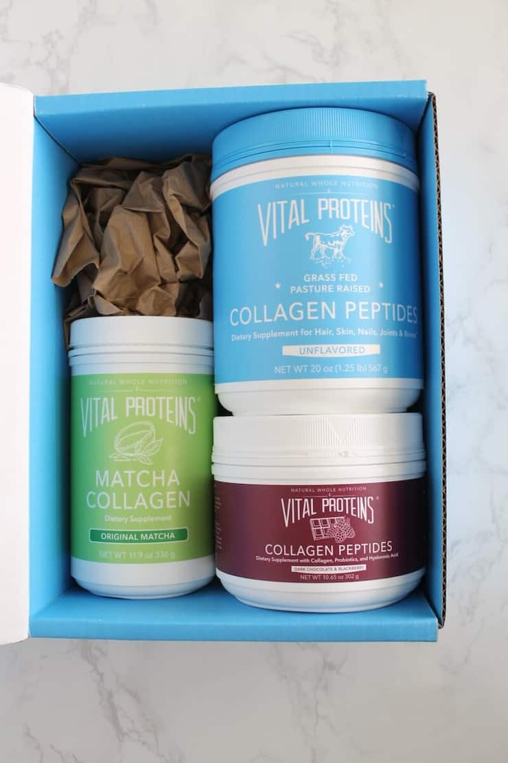 An oven box with 3 tubs of collagen proteins used to make matcha cookies
