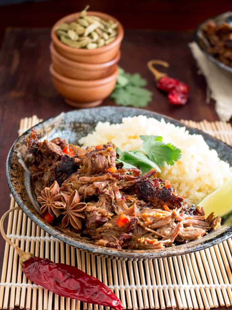 Slow cooker beef in a bowl with rice