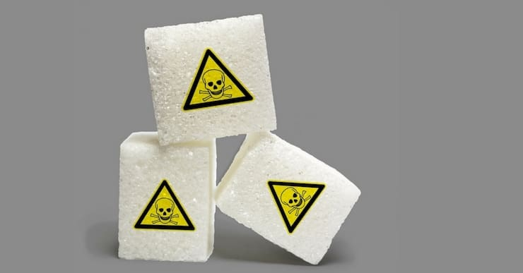 sugar cubes with yellow toxic triangle skull and crossbones on them