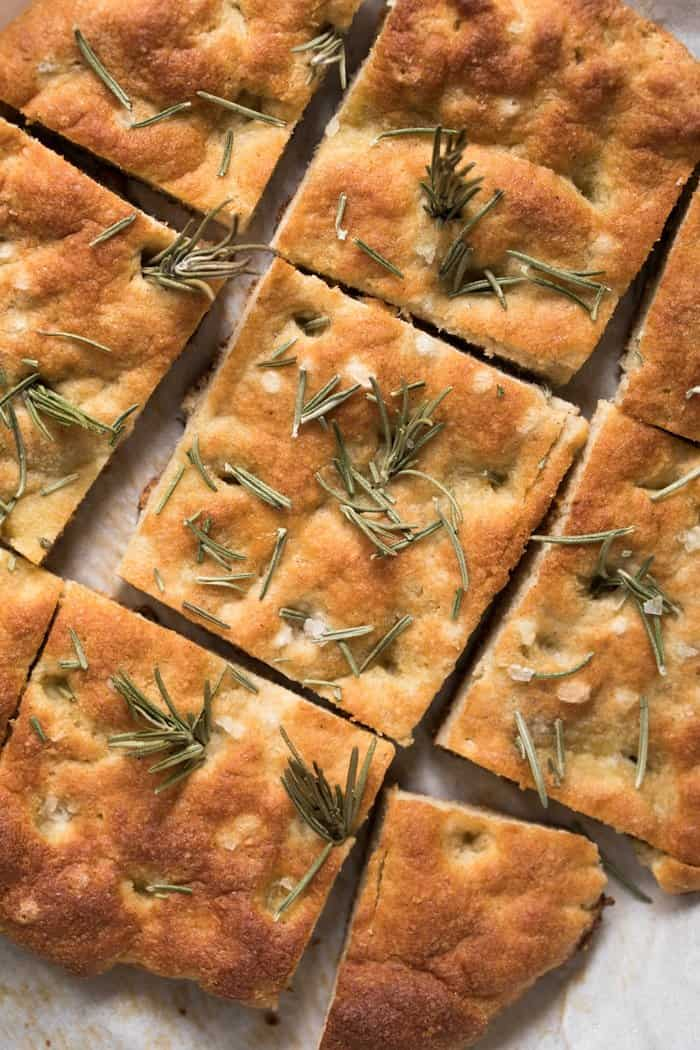 Close up of grain free focaccia bread topped with rosemary and sea salt cut into squares