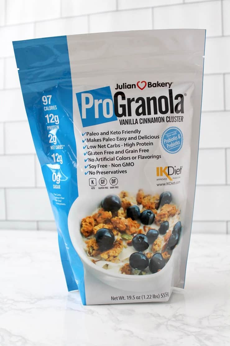 Bag of Julian Bakery ProGranola on white marble surface with white subway tile background