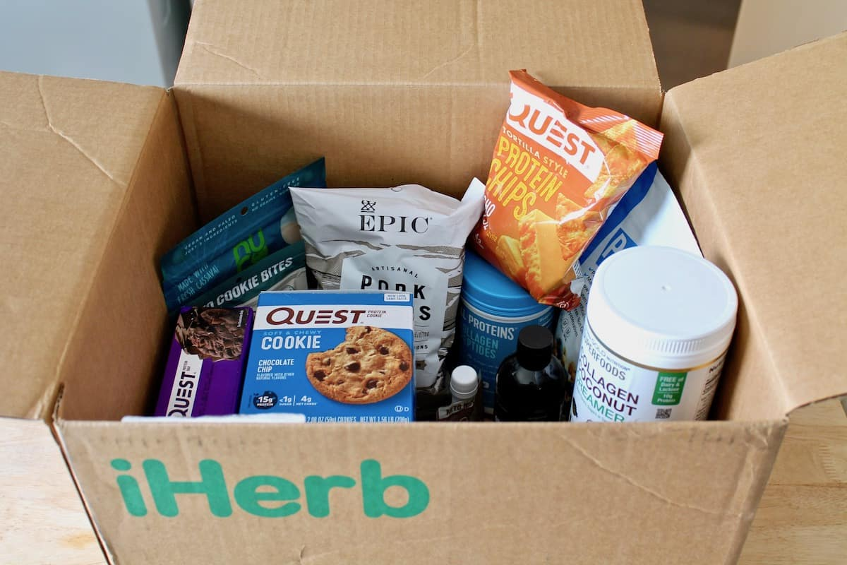 iherb cardboard box filled with various keto snacks